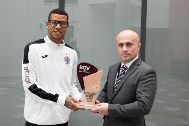 Hibernians' Taylon (left) receiving the accolade. Photo: BOV