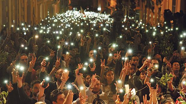 Demonstrators hold up their mobile phone flashlights at a demonstration in Sliema, organised by the Civil Society Network in the wake of the assassination of journalist Daphne Caruana Galizia. Photo: Chris Sant Fournier