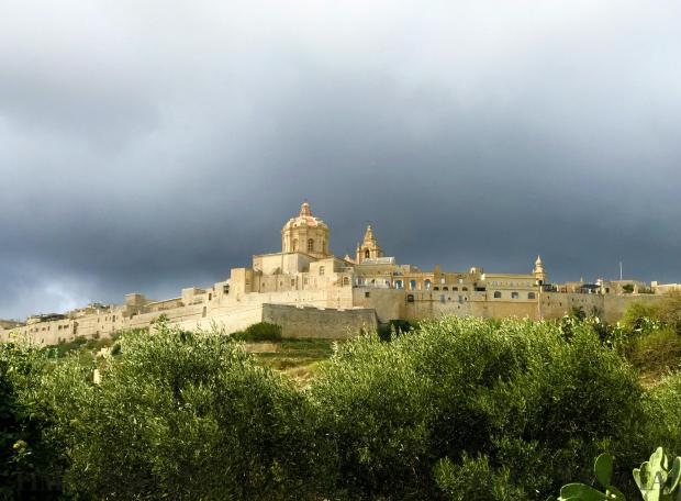 The Cathedral Church of Mdina engulfed with grey dark clouds on October 28. Photo: Mark Zammit Cordina
