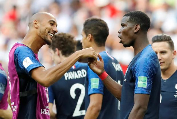 France's Steven Nzonzi and Paul Pogba celebrate after the match.