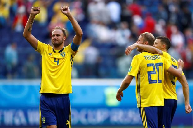 Sweden's Andreas Granqvist celebrates victory after the match.