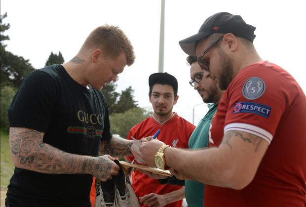 Ambassador for betting company Betsson and former Liverpool and Roma defender John Arne Riise signs autographs outside the Centenary Stadium in Ta'Qali shortly before attending a training session with Premier Club Valletta on April 10. Photo: Matthew Mirabelli