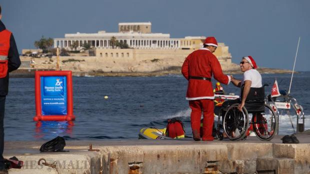 A man in a wheelchair prepares to take part in the Thomas Smith Charity Swim in Sliema on December 27. A total of 330 swimmers took the plunge in the 17th edition of the Thomas Smith charity swim, breaking all participation records for the annual event and raising €14,000 for the Malta Community Chest Fund. Photo: Steve Zammit Lupi