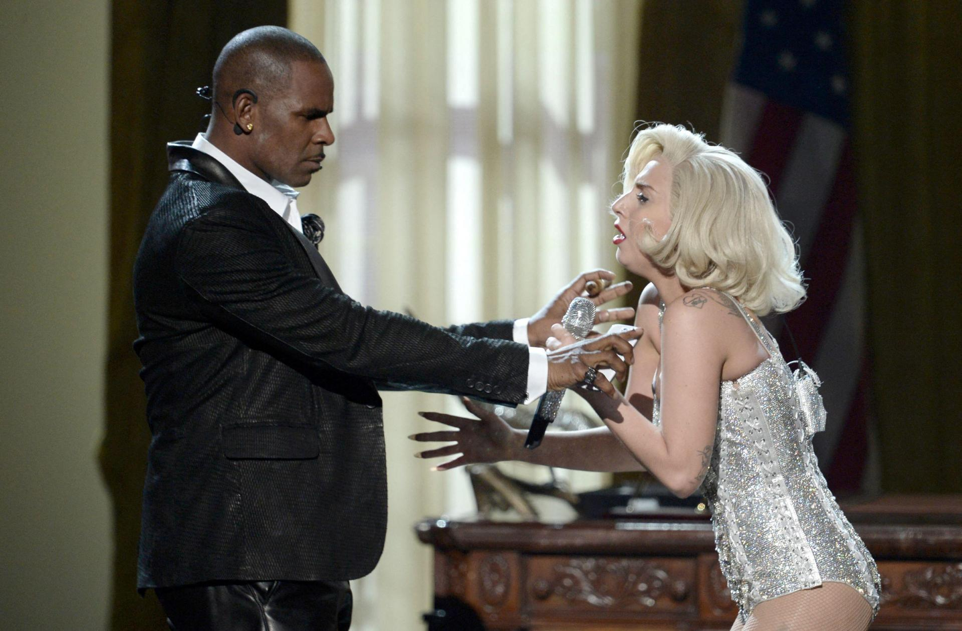Singers Lady Gaga and R. Kelly perform onstage during the 2013 American Music Awards. Lady Gaga has since apologised for her past collaborations with Kelly. Photo: Kevin Winter/Getty Images North America/Getty Images via AFP