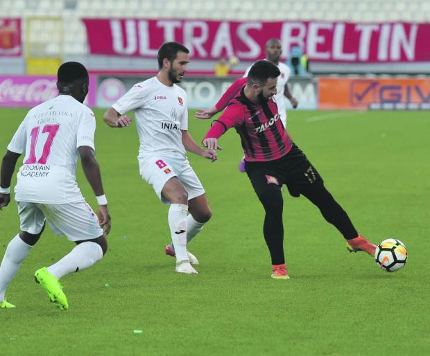 Ħamrun midfielder Artur Faria looks to move past Santiago Malano, of Valletta. Photo: Mark Zammit Cordina