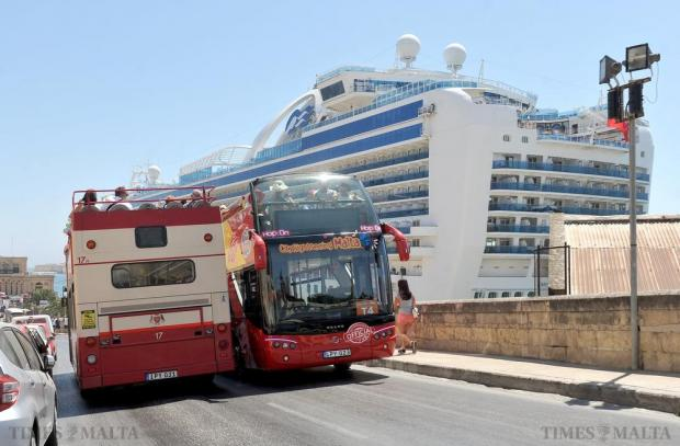 Tourist buses cross each other's path in Valletta on July 1. Photo: Chris Sant Fournier