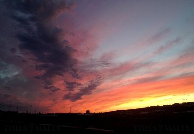 The sun sets behind the Manikata ridge on April 24. Photo: Chris Sant Fournier