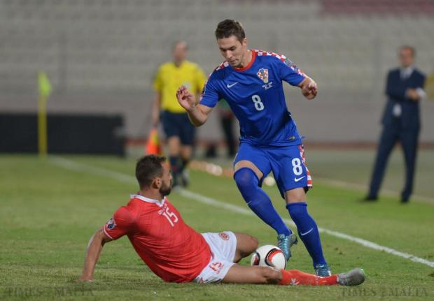 Malta's Steve Borg (left) tries to steal the ball from Croatia's Marko Pjaca (right) during their UEFA European Championship Qualifying match at the National Stadium in Ta'Qali, on October 13. Photo: Matthew Mirabelli