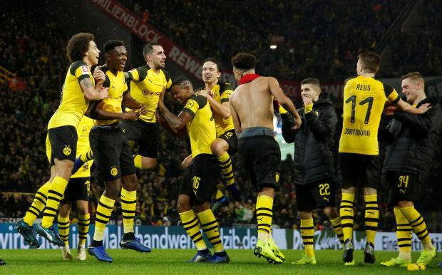 Borussia Dortmund players celebrate after the match.