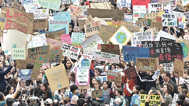 Students in Hong Kong take part in a global protest against climate change on Friday, part of the student movement called #FridaysForFuture aimed at sparking world leaders into action on climate change. Photo: Anthony Wallace/AFP