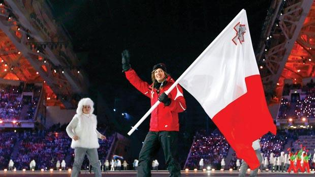 Malta's flag-bearer and sole member of the team Elise Pellegrin during the opening ceremony of the 2014 Sochi Winter Olympic Games yesterday. Photo: Brian Snyder/Reuters
