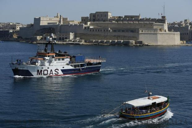 The Migrant Offshore Aid Station (MOAS) ship MV Phoenix (left) leaves Valletta's Grand Harbour for the start of its summer search and rescue operations in the central Mediterranean on June 6. Photo: Darrin Zammit Lupi
