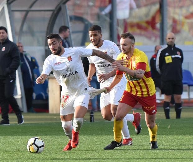 Miguel Alba of Valletta tries to break free from Ryan Scicluna of Birkirkara during a football match held at Ta' Qali Stadium on February 25. PHOTO: MARK ZAMMIT CORDINA