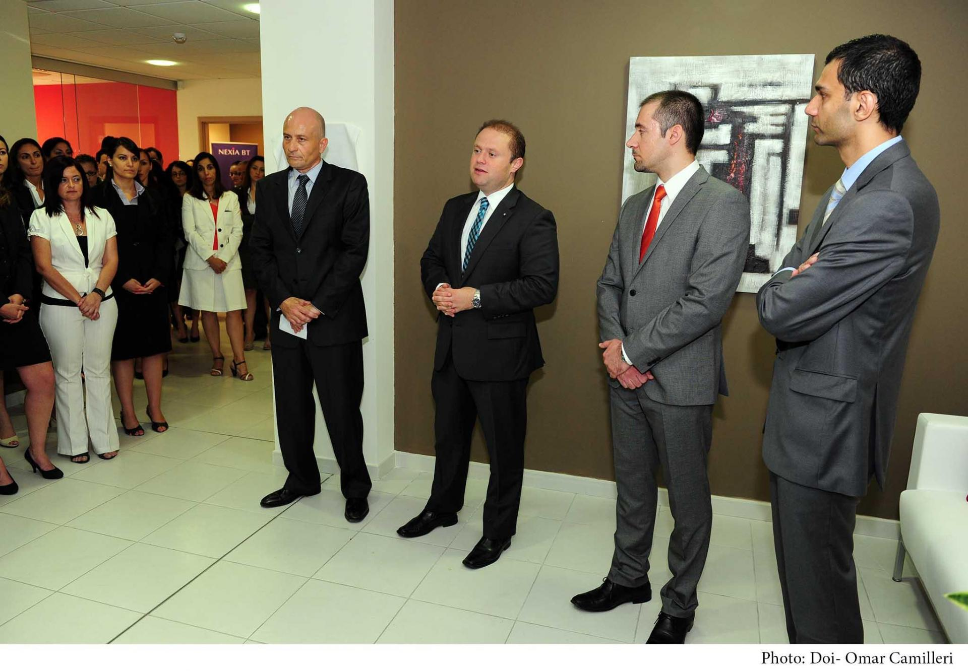 Joseph Muscat paying a visit to Nexia BT's offices in June 2013.