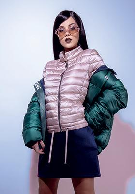 Pink lightweight jacket: Mango - €49.99. Green puffer jacket: Tommy Jeans - €219.00. Blue tracksuit skirt: Tommy Jeans - €79.90. Sliver boots: Tommy Jeans - €149.90. Sunglasses: Mango - €19.99.