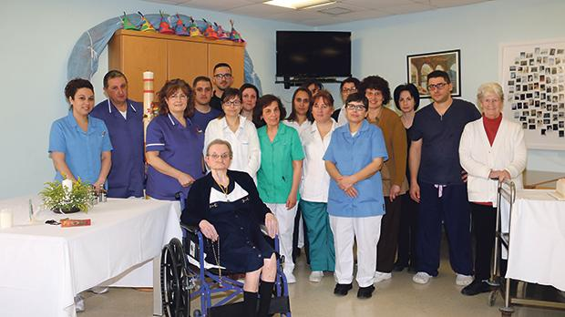 Rosemary La Roche, 75, surrounded by nurses and staff of St Anna home for the elderly. Photos: Charles Spiteri
