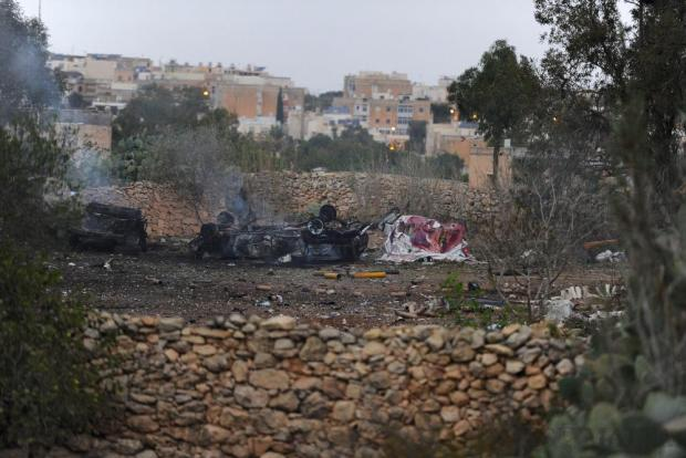 Remains of a car that was destroyed in a fireworks blast are seen in Gudja on October 30. Photo: Steve Zammit Lupi