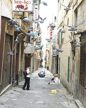 Strait Street is undergoing an economic, social and cultural regeneration. Photo taken from George Cini's book Strada Stretta 'The Gut' Which For Many Years Lit Up Valletta.