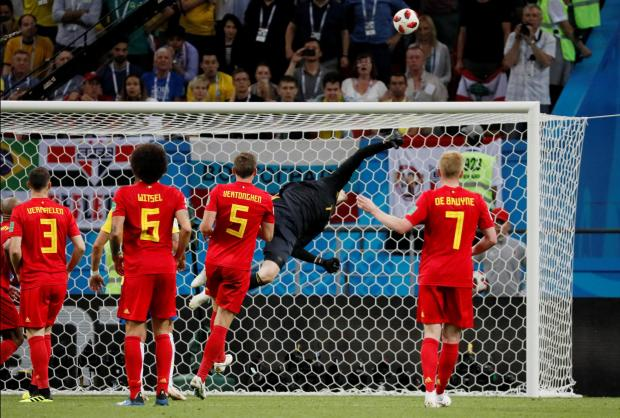 Belgium's Thibaut Courtois saves a shot from Brazil's Neymar.
