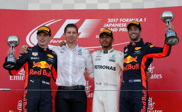 Mercedes' Lewis Hamilton of Britain celebrates winning the race with Red Bull's Daniel Ricciardo of Australia and Max Verstappen of the Netherlands.