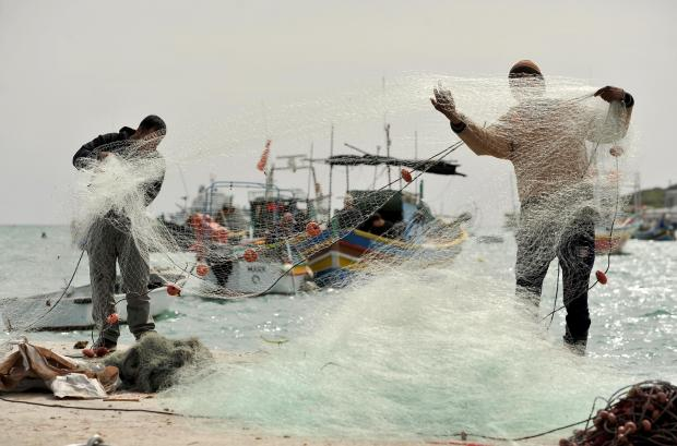 Fishermen prepare their nets at Marsaxlokk on March 7. Photo: Chris Sant Fournier