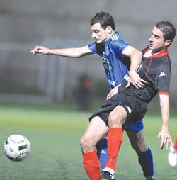 Marsaxlokk midfielder Gareth Sciberras (left) in a tussle for the ball with Ħamrun's David Camilleri. Photo: Matthew Mirabelli