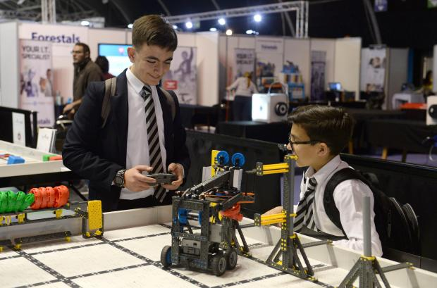 Two boys enjoy one of the exhibits at the Malta Robotics Olympiad at the MFCC grounds in Ta'Qali on April 20. Photo: Matthew Mirabelli