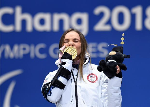 Oksana Masters kisses her gold medal in Pyeongchang.
