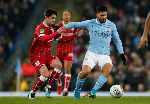 Manchester City's Sergio Aguero in action with Bristol City's Liam Walsh.