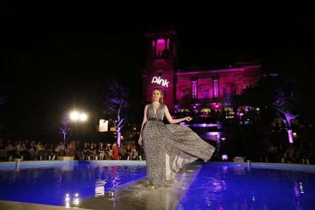 A model walks across a submerged catwalk as she presents a Rebelli creation during the sixth edition of the Pink Fashion Show at Villa Rosa in St Julian's on May 26. Photo: Darrin Zammit Lupi