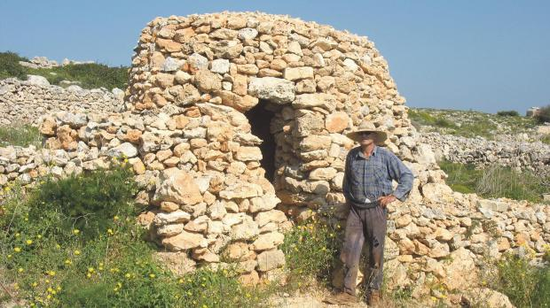 A farmer stands beside his girna in the Red Tower area, Mellieħa.