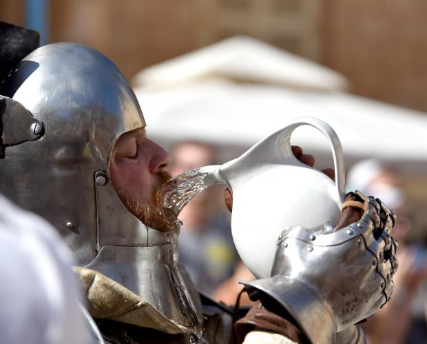 A reenactor drinks from a vase on a hot day before a medieval fight during the Medieval Mdina Festival on May 06. Photo: Mark Zammit Cordina