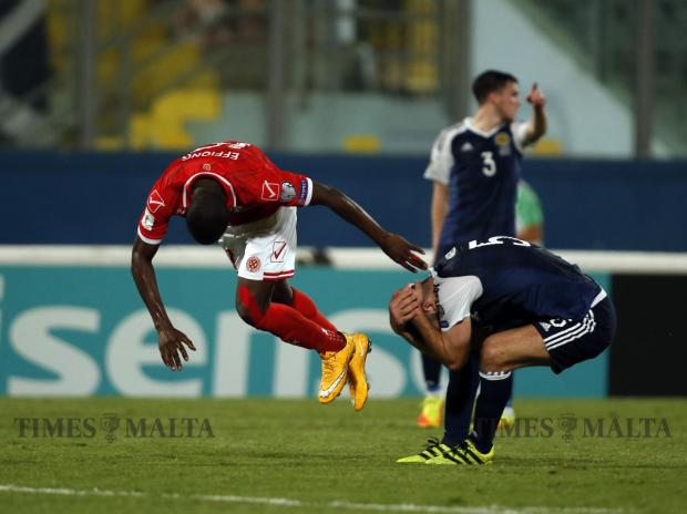 Scotland's Grant Hanley (right) and and Malta's Alfred Effiong clash during their 2018 World Cup qualifier at the National Stadium in Ta' Qali on September 4. Photo: Darrin Zammit Lupi