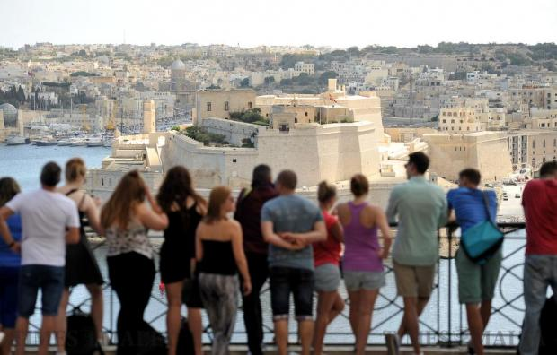 Tourists take in the dramatic view of Grand Harbour from the Upper Barrakka Gardens in Valletta on September 21. Photo: Chris Sant Fournier