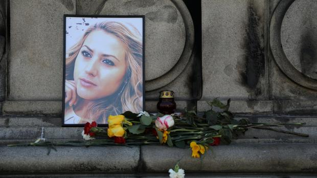 Flowers and candles are placed in memory of Bulgarian TV journalist Viktoria Marinova in Ruse, Bulgaria.