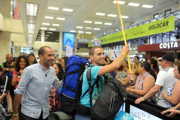 Luke Camenzuli (right) and Fr Clinton Farrugia from the MSSP cheer as they return to Malta on August 1, after attending World Youth Day celebrations in Krakow, Poland. Photo: Steve Zammit Lupi