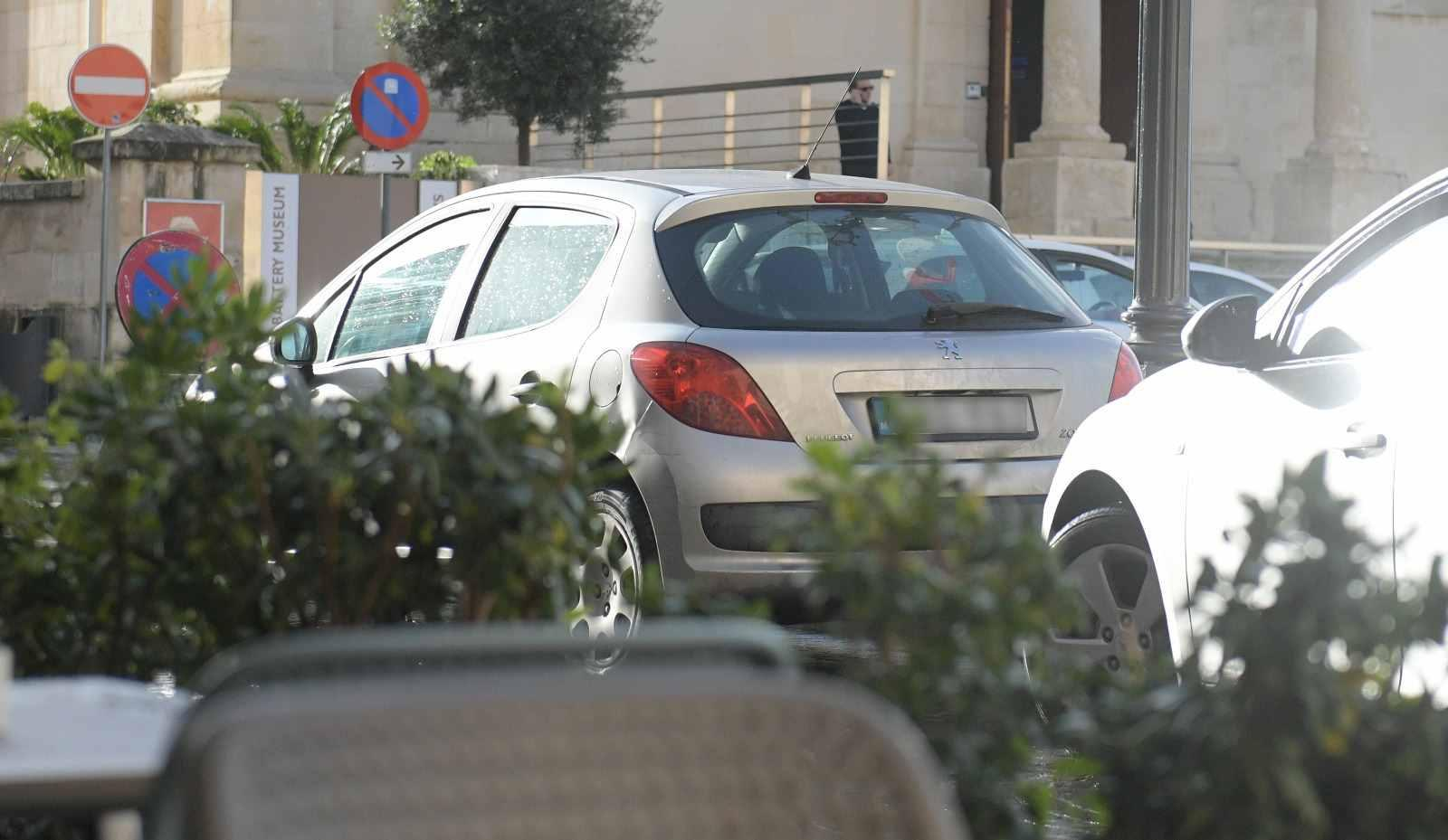 The government car that has been visiting Keith Schembri's home, seen parked outside the prime minister's office on Monday. Photo: Matthew Mirabelli