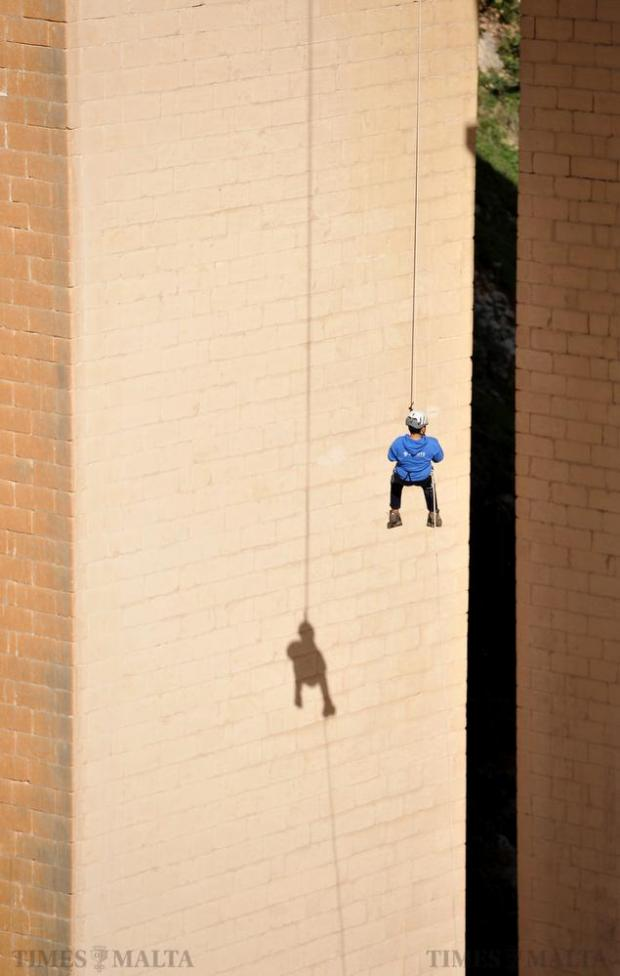 A person dangles from a rope during the 34-hour abseiling marathon at Mosta bridge on November 21. Photo: Chris Sant Fournier