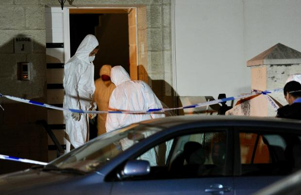 Forensic police enter the block of apartments where Brandon Pace, aged 21 was murdered following a heated argument in Giovanni Barbara street, Hamrun on April 2. Photo: Steve Zammit Lupi