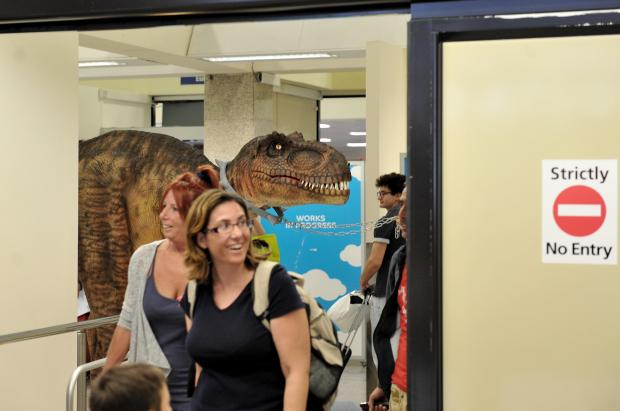 Dino the baby T-rex makes it's way to the Arrivals Lounge at the Malta International Airport on July 26. Photo: Chris Sant Fournier