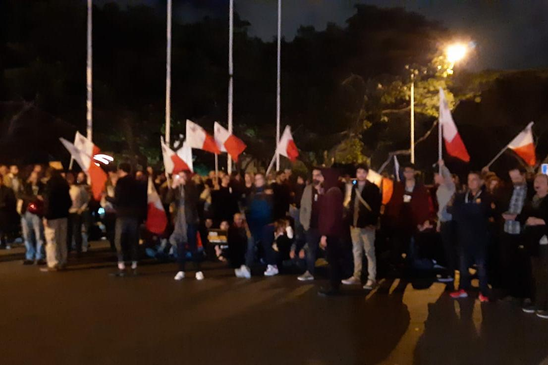 A group of protestors block the street in Floriana.