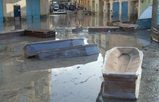 updated coffins float on floodwaters in qormi