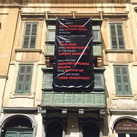 The banner, affixed to the facade of a house in Old Bakery Street, which was removed by the Planning Authority.