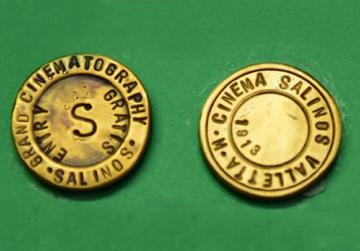 Two tokens used at Salinos Cinema in Strada Reale, Valletta