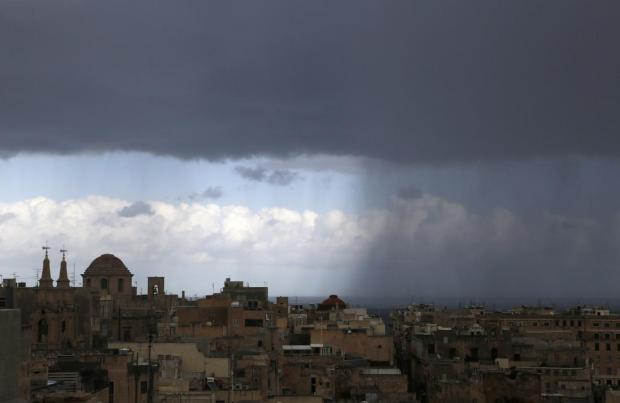 Dark clouds and heavy rainfall approach Valletta on January 26. Photo: Darrin Zammit Lupi