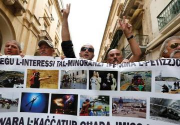 "Hunters march down Valletta's Republic Street carrying a banner that reads: ""Protecting the interests of minorities, sign the petition here. After the hunter, it's your turn."""