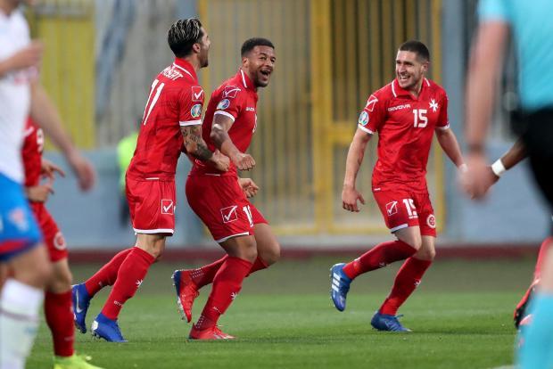 Kyrian Nwoko (centre) celebrates his goal with Rowen Muscat (left) and Juan Corbalan. Photo: Domenic Aquilina