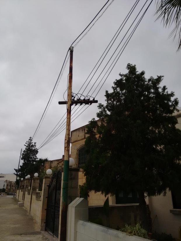 A rusted electricity pole was split in two in Jean Houel Street, Naxxar.