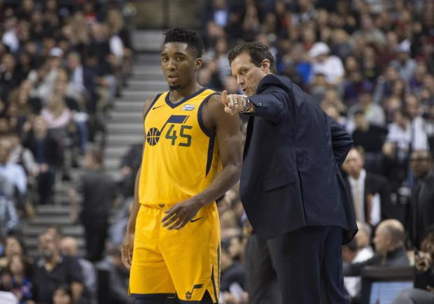 Utah Jazz guard Donovan Mitchell (45) talks with Utah head coach Quin Snyder.