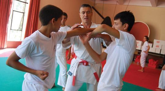Santo Torre (centre) supervises training.